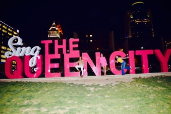 sing the queen city sign picture